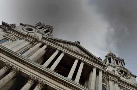 St Pauls Cathedral facade at angle under grey sky photo