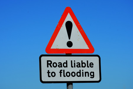 liable: Road liable to flooding sign