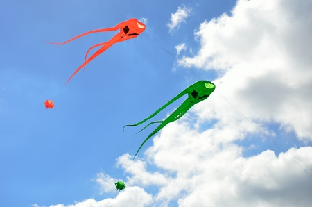 invader: Orange and green space invader kites Stock Photo