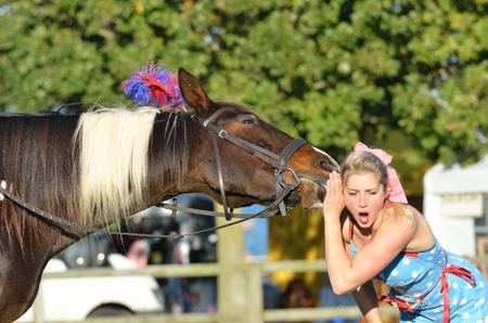 IPSWICH SUFFOLK  UK  25 October 2014:  East Anglia Equestrian Fair shocked girl listening to talking horse 新闻类图片