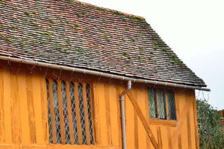 half timbered house: end of orange half timbered house Stock Photo