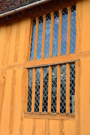 half timbered house: Window on orange half timbered house Stock Photo