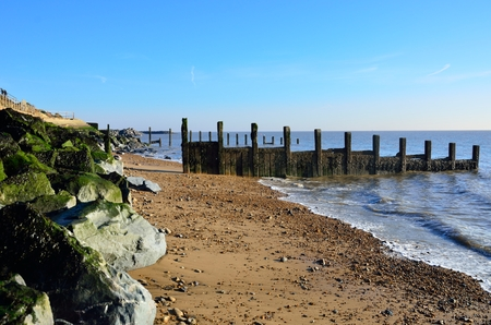 groyne: Essex Coastline with wooden Groyne