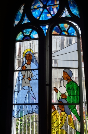 mary mother of jesus: Caribbean stained glass Stock Photo