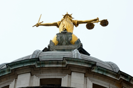 Looking up at justice statue old bailey