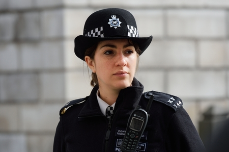 police officer: CITY OF LONDON ENGLAND 13 March 2015:  Metropolitan Policewoman on duty
