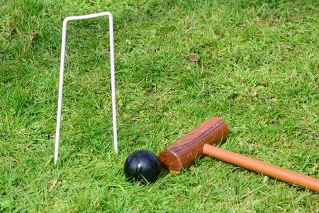 yard stick: Croquet equipment on ground
