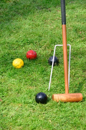 Croquet mallet with balls photo