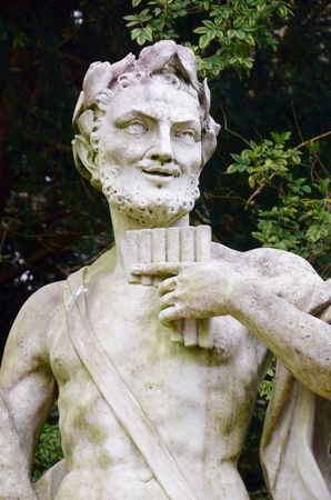 panpipe: Stone statue of pan with pipes
