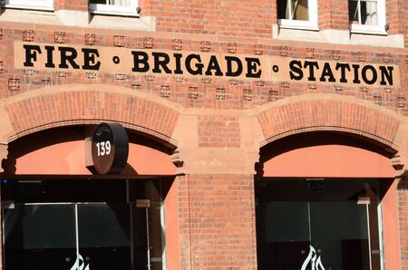 fire brick: Front of red brick fire station Editorial