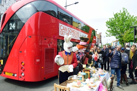 busker: CAMDEN HIGH STREET LONDON  ENGLAND  5 May  2015:  Mad Hatters Tea Party on street