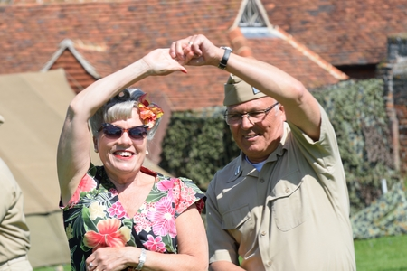 CRESSING TEMPLE ENGLAND 17 May 2015: Senior couple in costume jiving