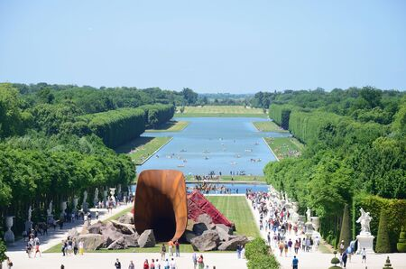 versailles: VERSAILLES PARIS FRANCE 6 JUNE  2015: Overlooking Versailles Garden with controversial Dirty Corner Art installation