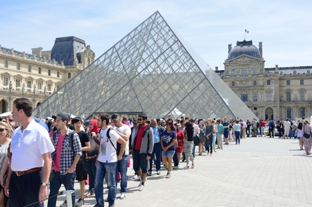museums: PARIS FRANCE 7 JUNE  2015: Large queue outside louvre Paris