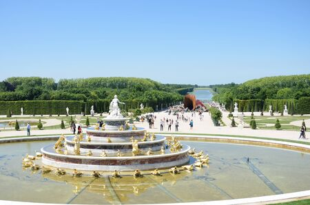 versailles: VERSAILLES PARIS FRANCE 6 JUNE  2015: Latona  fountain at Versailles Palace with gardens in background