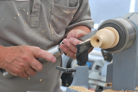 wood turning: Man working at small wood lathe