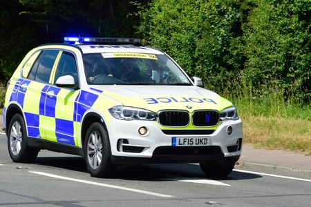 escort: ESSEX  UK 7 JUNE  2015: Police Escort BMW