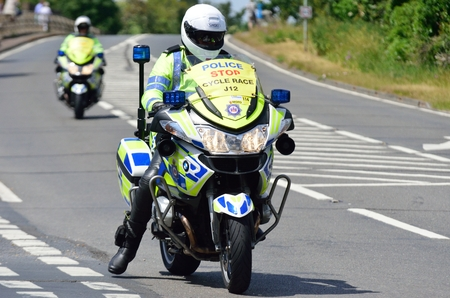 escort: ESSEX  UK 7 JUNE  2015: Police Escort Motorcyclist