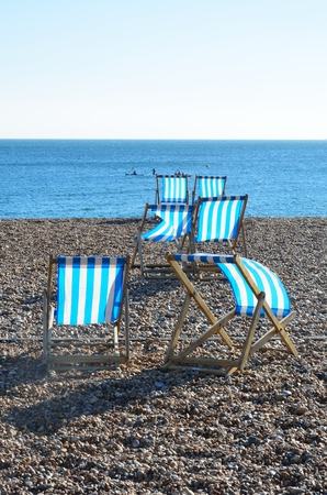 shingle beach: Deckchairs on shingle beach
