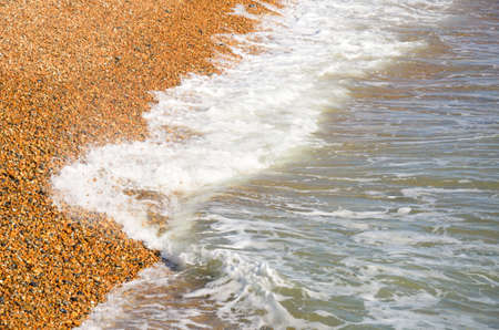 Waves on shingle Stock Photo