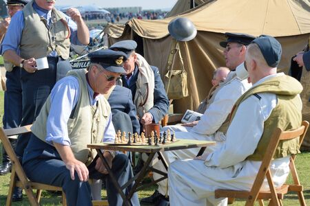world war two: DUXFORD CAMBRIDGESHIRE UK 20 August 2015: Playing chess awaiting scramble in World War Two reenactment