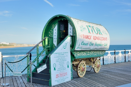 BRIGHTON SUSSEX  UK 29 September  2015: Tarot reader caravan on pier Editorial