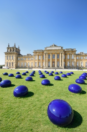 woodstock: BLENHEIM PALACE WOODSTOCK OXFORD UK 21 April 2015: Blenheim palace with modern art installation in Foreground
