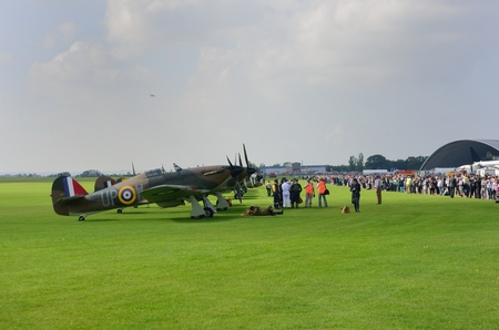 world war 2: DUXFORD CAMBRIDGESHIRE UK 20  August 2015: Line up of historic World War 2 spitfires with crowd