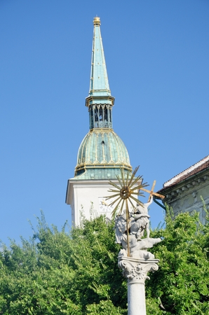 plague: Plague Monument with St Martins Cathedral Tower Bratislava Slovakia Stock Photo