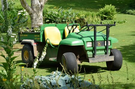 agriculture machinery: ESSEX  UK 7 JUNE  2015: Horticultural tractor in garden