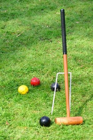 yard stick: Croquet Mallet and Balls Stock Photo