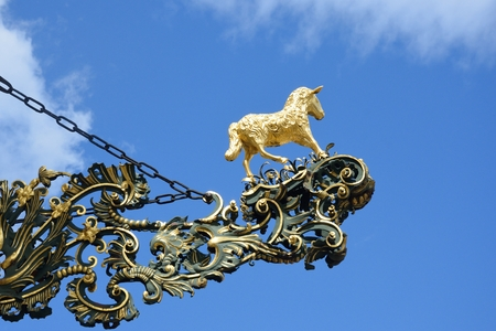 sheep sign: Golden lamb statue and sign