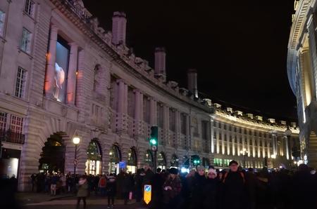 exhibition crowd: LUMIERE FESTIVAL LONDON UK  17 JANUARY 2016:  Crowd viewing Lumiere exhibition in Regent Street