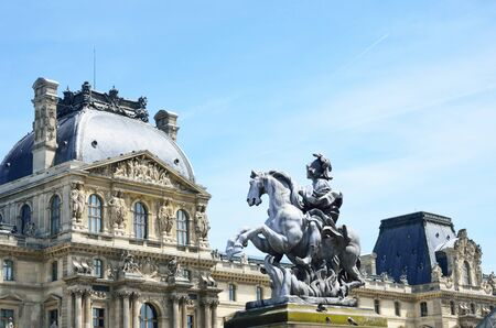 louis: Statue of Louis ivx outside louvre museum Editorial