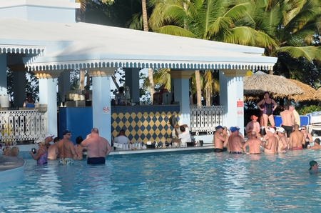 side bar: RIEU BACHATA RESORT DOMINICAN REPUBLIC  4 FEBRUARY  2016: Holidaymakers at Pool side bar