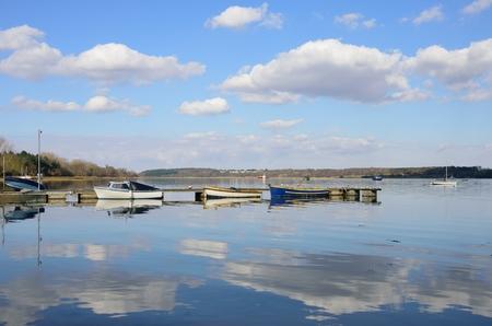 estuary: Boats in English Estuary Suffolk Stock Photo