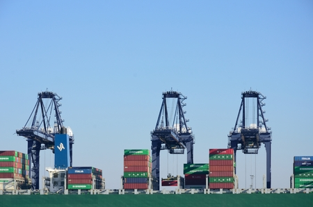 unloading: PORT OF FELIXSTOWE SUFFOLK UK  24 FEBRUARY 2016: Large Container Cranes Unloading Editorial