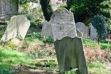 tombstones: Sloping tombstones in ancient English graveyard