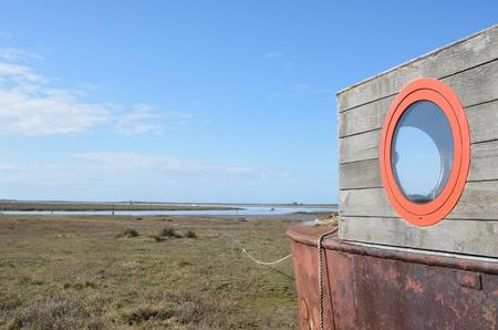 estuary: Houseboat overlooking deserted estuary