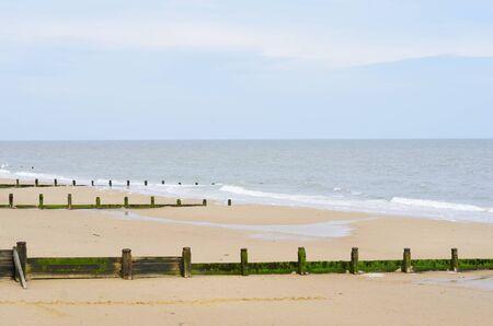 breakwaters: Sandy beach with breakwaters Stock Photo