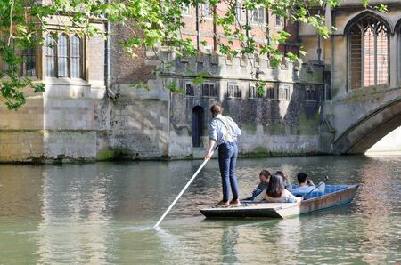 punter: Cambridge England, United Kingdom -May 20, 2016: Punter in braces guiding  tourists on Cam Cambridge England