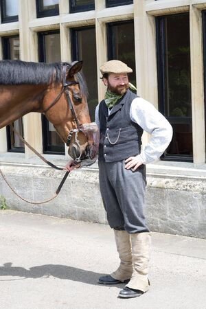 squire: Audley End England, United Kingdom -May 22, 2016: Man with horse in historical clothing