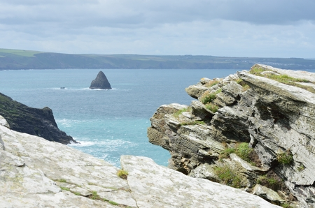 large rock: Large Rock with coastline in background
