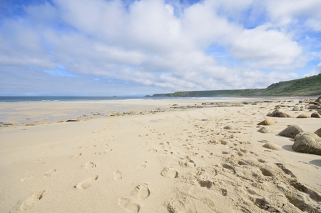 sennen: Large Empty Beach with footprints in Sand
