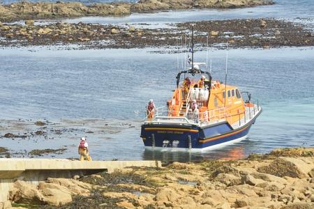 sennen: Sennen Cove Cornwall , United Kingdom - July 02, 2016:  RNLI lifeboat returning up ramp