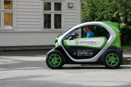 micro drive: Flam  Norway -  July  30, 2016: Man driving very small eco car on tour in Flam