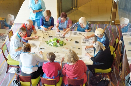 North Sea  England, United Kingdom -  July  28, 2016: Art class taking place on cruise with small group of passengers