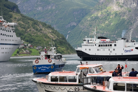 tour boats: Geiranger  Norway -  July  31, 2016: Busy harbour at Geiranger with various tour boats Editorial