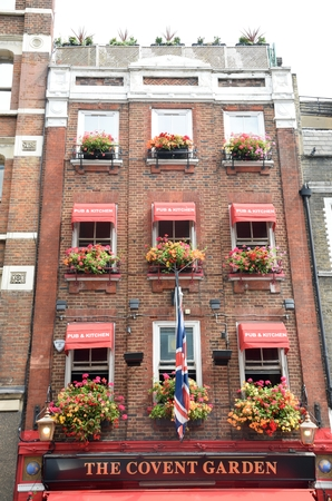 covent: Covent Garden London England, United Kingdom - August 16, 2016: Covent Garden Pub with Flower Baskets
