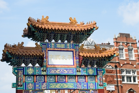 archways: China Town London England, United Kingdom - August 16, 2016: Large Ornate Arch marking Entrance to Londons Chinatown
